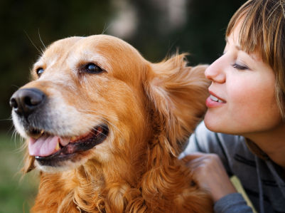 woman with golden retriever